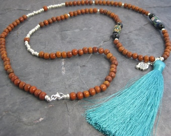 Long turquoise tassel necklace with wood beads, sterling silver, African trade beads and southwest charm