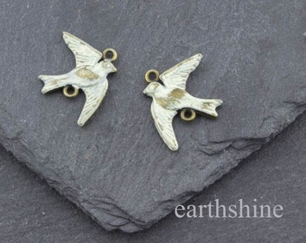 Pair antique bronze swallows hand painted with pale cream patina