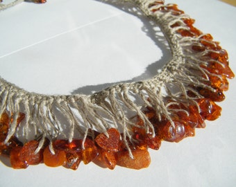 "Summer Jewelry. Natural crocheted linen necklace ""Sunny"" with polished dark brownish red genuine Baltic amber pieces"