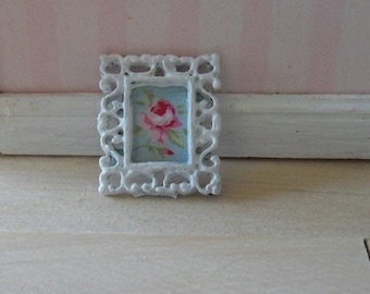Metal frame with rose motif