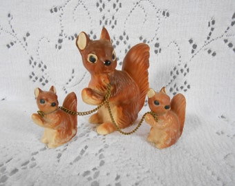 Vintage Figurine Mother Squirrel and her Two Babies, original chain (rare to find with chains still attached))