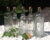 40 Glass Bottles 4 Ounce to be shipped with the tags and charms