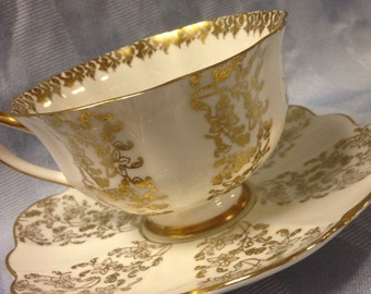 SHELLEY Gold and White Teacup and Saucer Set