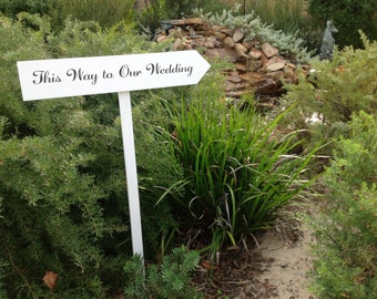 This way to our wedding sign