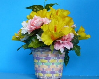 Floral Arrangement, Silk Flowers in Bright Yellow, Pink and White in a colorful wicker basket.