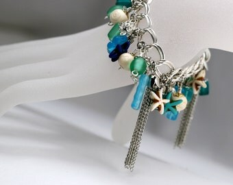 Charm bracelet with miscellaneous glass and bone beads