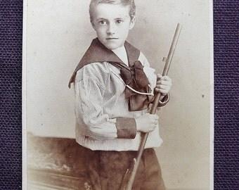 Carte-de-visite, antique, it features a boy in a sailor suit brandishing a rifle. H.W. Winter, Derby. c1890's.
