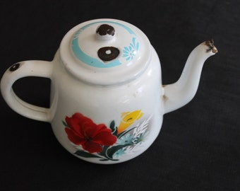 white enamel teapot red yellow flowers