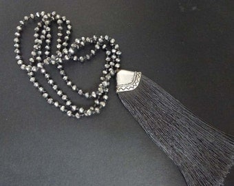 Tassel necklace with hand knotted crystal beads and silver cap