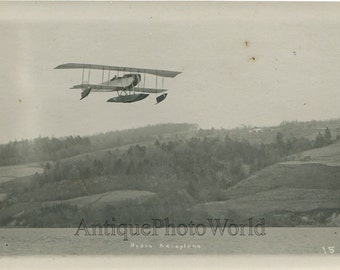 Hydro airplane biplane in flight antique aviation photo