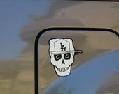 Day of the Dead Skull Sticker  wearing L.A. baseball cap.   #61