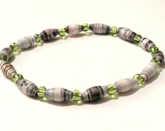 Grey and lime green bracelet with magazine rolled paper beads. Upcycled, recycled bracelet with stretch cord