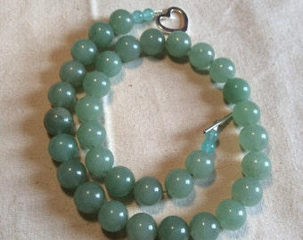 Lovely natural looking green Amazonite necklace trimmed with sea glass.