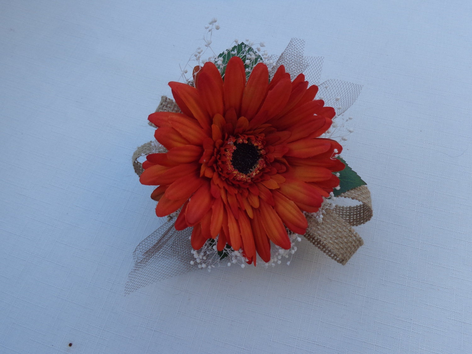 Corsage Designed With A Orange Gerber Daisy Trimmed With