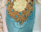 Sea green and gold decorated pointe shoe. Classical variations.
