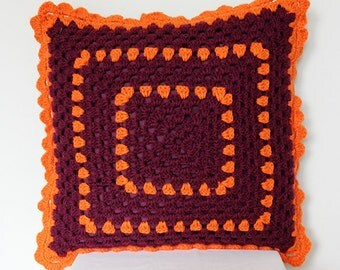 Crochet pillow in purple and orange