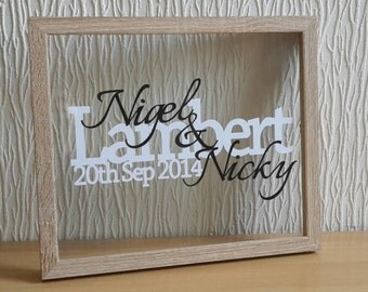 Surname papercut, perfect for a wedding or anniversary, in a gorgeous floating frame