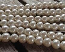 Strand 8mm Glass Pearl, Off White Cream Color. 54 Pearls Per Strand. 1 mm Hole.
