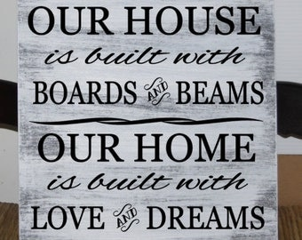 Primitive - Our house is built with boards and beams, Our home is built with love and dreams wood sign - 12 x 12