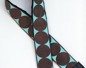 Dots mint and brown SLR camera strap with neck pad and tripod mount spinner
