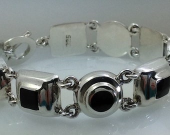 Bold heavy Sterling silver and onyx handbracelet