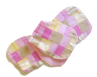 Baby burp cloths, contoured burp cloths, pink burp cloths, reversible burp rags, flannel burp cloths, terrycloth burpies, pink burp rags