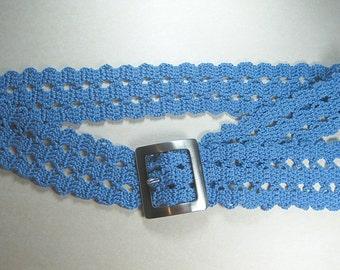 A blue crochet belt, bruge belt, bruge lace