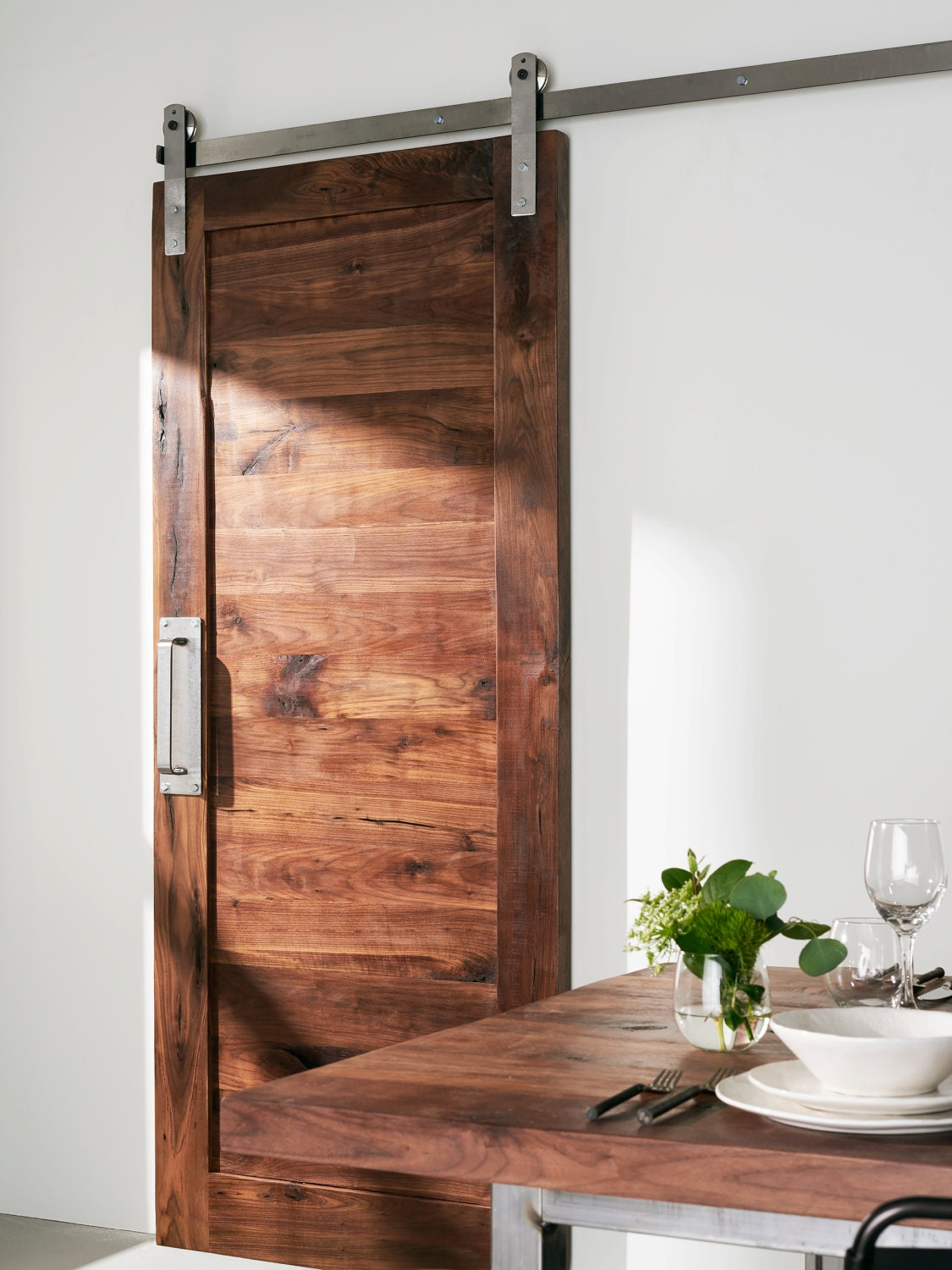 Custom built solid walnut barn door for Custom sliding doors