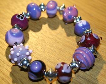 Beautiful pink and purple lampwork bracelet