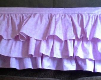 Three tiered pink ruffle crib skirt