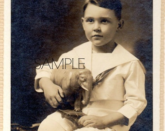 Vintage photo of victorian boy with elephant