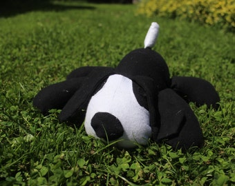 Black and white stuffed puppy/toy