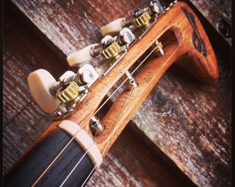 Fretless electric guitar by DaShtick guitars. Celtic folk instrument. CBG
