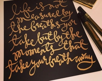 Life is not measured...gold on black print
