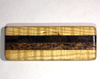 Comb in the case of pearl ash, stained birch wood and burl walnut