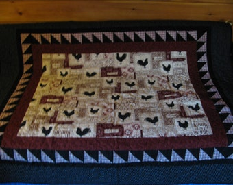 A quilted table cloth of Chickens and Roosters . Memories of growing up on the farm.