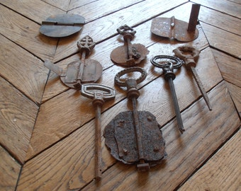A group of rusty French vintage keys or utensils