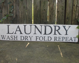 wood painted laundry sign