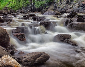 Waterfalls of a stream in the boreal forest.