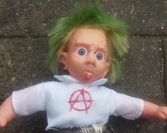 Punk anarchist pierced ooak vinyl plastic doll repaint