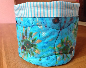 Basket/box/storage container. Hand painted and quilted with waterproof lining. Reversible