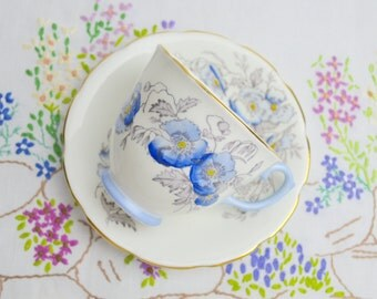 SALE SALE SALE 1930s hand painted china cup and saucer, blue poppies by spencer stevenson was 14.99 now 9.99