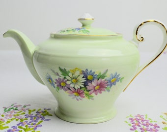 stunning tea pot by Aynsley, in a beautiful shade of green and adorned with floral images