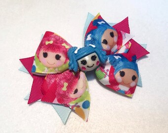 Lalaloopsy Hair Bow - 5 inch Stacked Boutique Pinwheel Bow with Blue Lalaloopsy Girl Center Embellishment on Partially Lined Clip