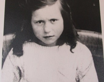 Small Vintage 1930s Black and White Photograph of a Serious Looking Girl