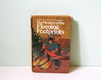 1971 Hardcover edition of The Mystery of the Flaming Footprint edited by Random House