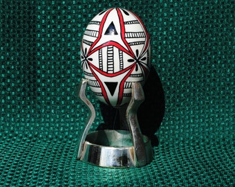 Stand included. Reminiscent of Ukrainian made eggs, Pysanky design, Pisanki, painted egg
