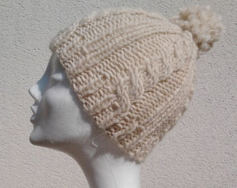 Cream hat with cables and Pompom