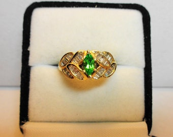 Tsavorite Garnet Ring 14kt.      14kt. Gold Ring with Tsavorite Garnet Marquise and Diamond Accents.