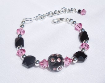 Black, pink and silver large bead bracelet